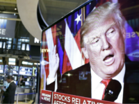 In this Nov. 9, 2016, file photo an image of President-elect Donald Trump appears on a television screen on the floor of the New York Stock Exchange. President Trump has maintained an uncharacteristic silence since the stock market took a nose dive, notable for a businessman president who regularly points …