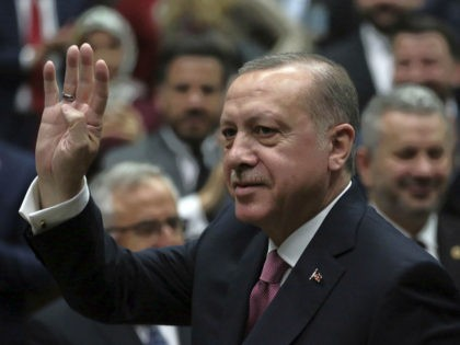 Turkey's President Recep Tayyip Erdogan waves as he arrives to address members of his ruling party at the parliament in Ankara, Turkey, Tuesday, Feb. 20, 2018. Erdogan said Turkish troops involved in an offensive to drive out Syrian Kurdish militiamen from a Syrian enclave will soon begin a siege of …