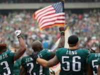 Philadelphia Eagles players stand during the National Anthem on October 8, 2017 in Philadelphia, Pennsylvania