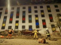 Rescure workers search the damaged Marshal Hotel in Hualien