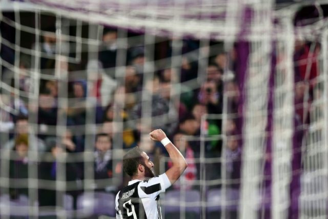 50 up: Juventus striker Gonzalo Higuain celebrates scoring his 50th goal for the Italian giants in Friday's win at Fiorentina
