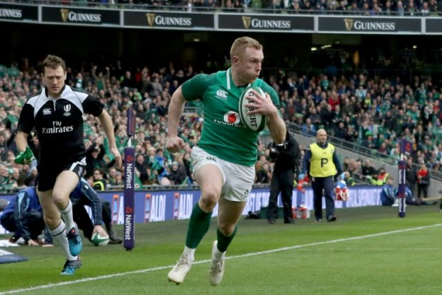 Ireland's wing Keith Earls runs in their fourth try in a 56-19 Six Nations drubbing of Italy