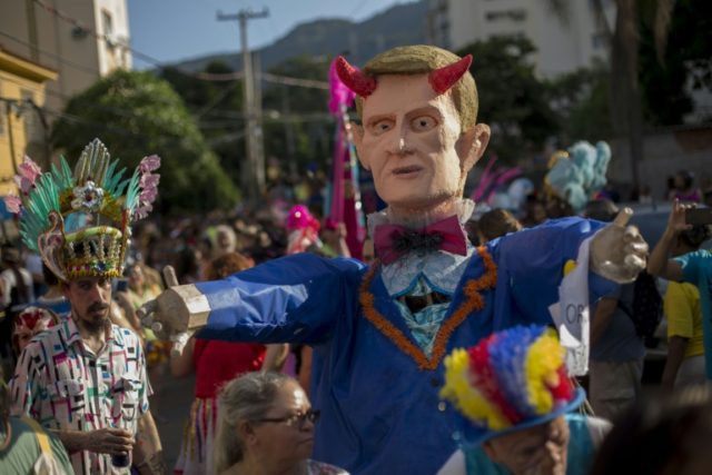 "A giant puppet of Rio Mayor Marcelo Crivella is seen during the street carnival parade of the ""Loucura Suburbana"" in Rio de Janeiro, Brazil, on February 8, 2018"