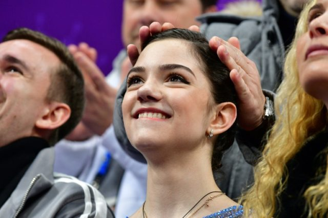 Russia's Evgenia Medvedeva watches her point scores after competing in the figure skating team event women's single skating short program during the Pyeongchang 2018 Winter Olympic Games on Sunday.