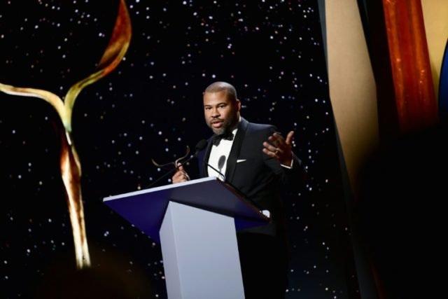 """Writer-director Jordan Peele picked up the trophy for best original screenplay for """"Get Out,"""" a dark satire of the African-American experience and liberal white guilt, at the Writers Guild of America Awards"""