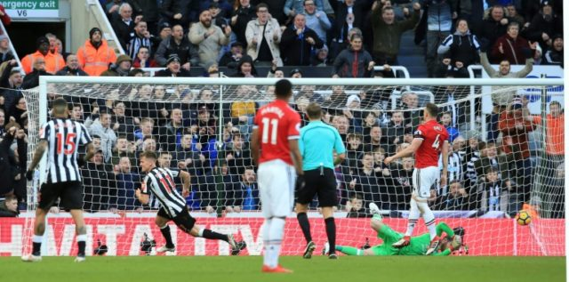 Newcastle United's midfielder Matt Ritchie (2ndL) celebrates after scoring on February 11, 2018