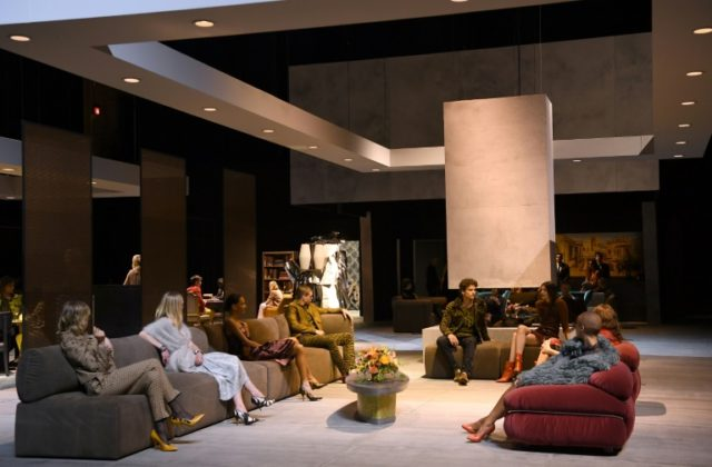 Models sit during the Bottega Veneta Fall/Winter 2018 fashion show, one of the most coveted tickets in an otherwise flailing Fashion Week as top US talent decamps to Europe