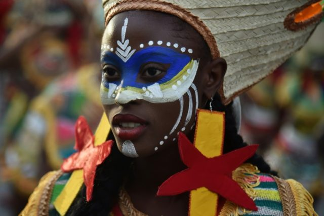 Dancers perform on the first day of the Haiti's national carnival parade in Port-au-Prince