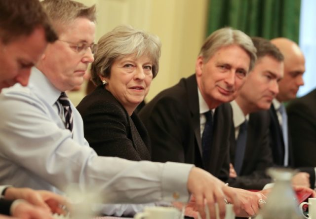 Britain's Prime Minister Theresa May (C) leads a cabinet meeting flanked by Chancellor of the Exchequer Philip Hammond (3 R) following a reshuffle at 10 Downing Street in central London on January 9, 2018