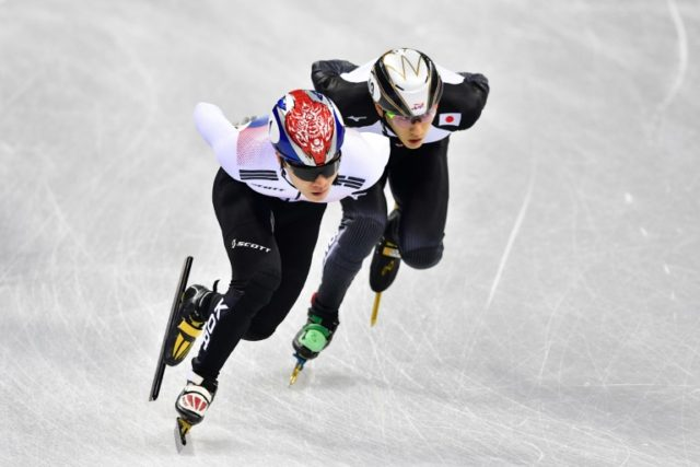 Japan's Kei Saito (R) takes part in the men's 1,500m short track speed skating heat event during the Pyeongchang 2018 Winter Olympic Games