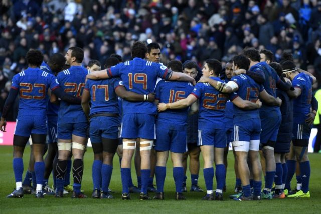 France players huddle after the Six Nations match against Scotland at Murrayfield Stadium in Edinburgh on February 11, 2018