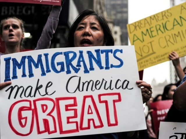 Protestors in New York rally for the Deferred Action for Childhood Arrivals (DACA) program, also known as the Dream Act, which protects immigrants who came to the United States illegally as children