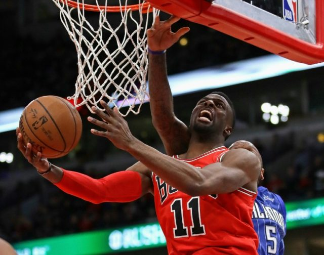 David Nwaba of the Chicago Bulls is fouled by Marreese Speights of the Orlando Magic during a 105-101 victory for the Bulls