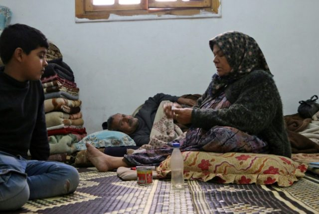 Amuna Hassan sits in an apartment in the Kurdish Syrian town of Afrin where her family is taking shelter with half a dozen other families after fleeing from a three-week assault by Turkey and allied Syrian rebels along the border
