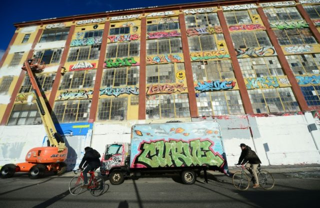 "New York's ""5Pointz,"" an urban canvas of graffiti art, is seen here November 19, 2013 as work began to paint the building white ahead of its demolition"