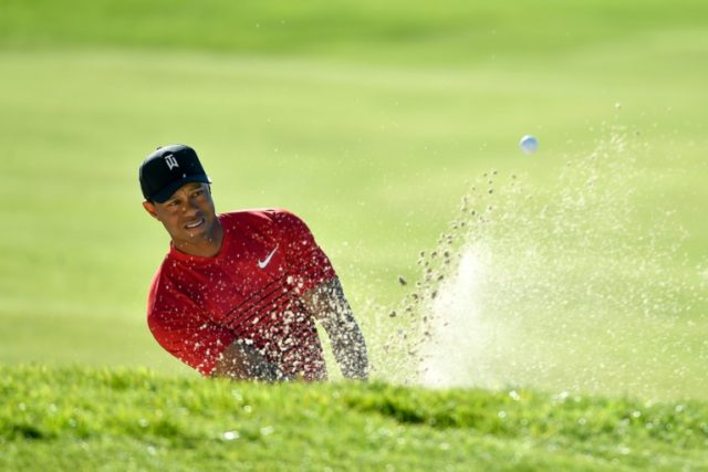 Tiger Woods plays a shot from a bunker on the 15th hole during the final round of the Farmers Insurance Open at Torrey Pines South on January 28, 2018 in San Diego, California