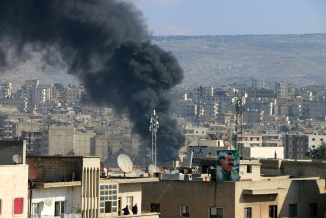 Smoke is seen billowing from the northern Syrian Kurdish town of Afrin on January 31, 2018