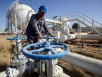 An Iraqi worker checks pipelines at the Bai Hassan oil field on October 19, 2017