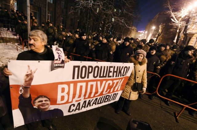 """""""Poroshenko is not my president,"""" reads a banner held by supporters of Mikheil Saakashvili"""