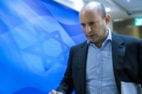 Education Minister Naftali Bennett, a key member of Israel's coalition government, has criticised Prime Minister Benjamin Netanyahu's behaviour after police recommended his indictment for corruption but said he would remain in the government