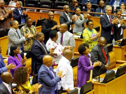 Members of parliament applaud Cyril Ramaphosa (front right) after naming him incoming president of South Africa