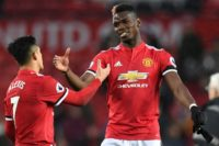 An unspecified illness saw Paul Pogba (R) withdraw on the morning of Manchester United's match in Huddersfield