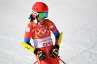 A plucky North Korean skier earned the biggest cheer of the day at the women's giant slalom Thursday after a display that brought back memories of glorious Olympic no-hopers