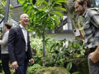 Amazon CEO Jeff Bezos tours the facility at the grand opening of the Amazon Spheres rainforest-inspired offices in Seattle, Washington on January 29, 2018
