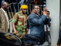 Zimbabwe's President Emmerson Mnangagwa arrives for a visit at the home of late opposition leader Morgan Tsvangirai, who died in South Africa last week, to express his condolences to the family.