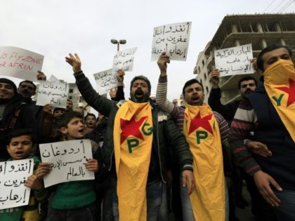 Syrian Kurds march in the northern Syrian city of Afrin during a February 4, 2018 demonstration against the Turkish-led military assault on the enclave
