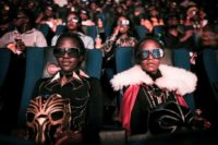 "Fans watch the film ""Black Panther"" in 3D during a cosplay screening in Nairobi, Kenya"