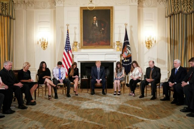 US President Donald Trump (C), who met with survivors of a mass shooting at a Florida high school, is pushing the idea of arming teachers to keep schools safe