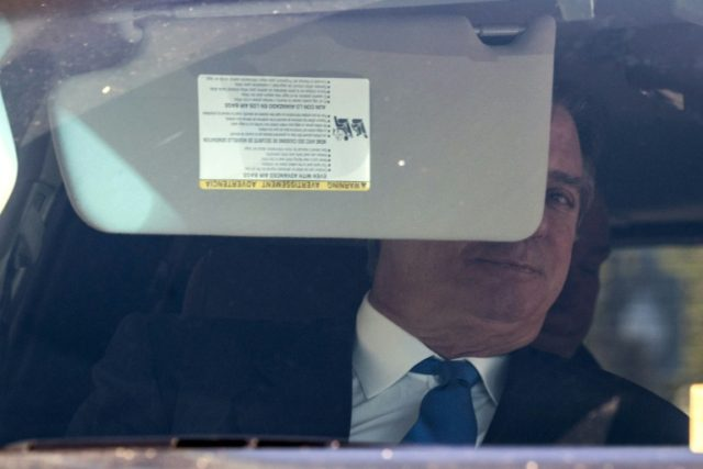 Already indicted for money laundering and tax evasion, Paul Manafort, seen here after leaving a federal court in October 2017, and his associate Rick Gates were charged in a separate 32-count indictment with defrauding the US Internal Revenue Service