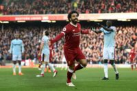King of Egypt: Mohamed Salah celebrates scoring for the sixth straight game as Liverpool beat West Ham 4-1