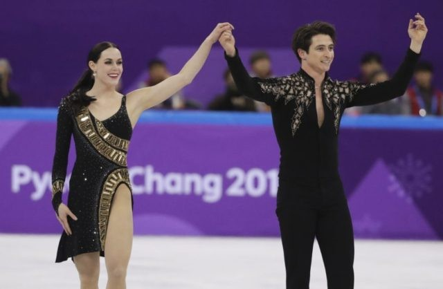 The Latest: Canada announces final team figure skaters