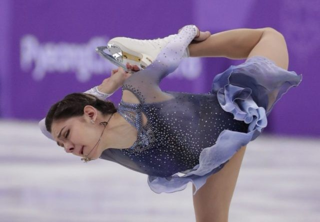 The Latest: Canada maintains lead in team figure skating