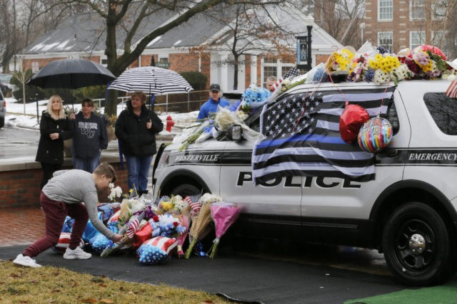 Police to escort bodies of 2 slain officers to funeral homes