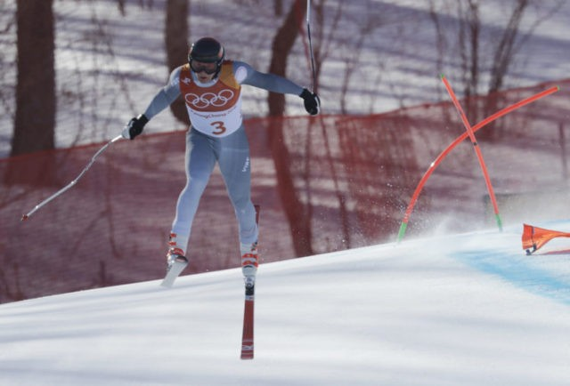The Latest: Alpine skiing finally underway at Winter Games