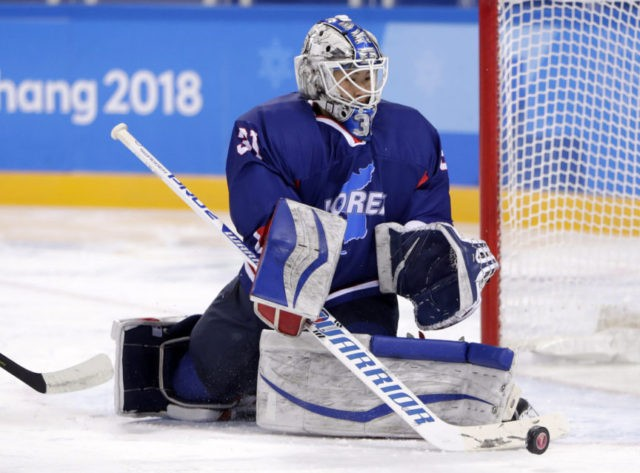 The Latest: Korea vs. Japan hockey match could be intense