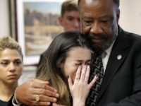 Aria Siccone, 14, a 9th grade student survivor from Marjory Stoneman Douglas High School, where more than a dozen students and faculty were killed in a mass shooting on Wednesday, cries as she recounts her story from that day, while state Rep. Barrinton Russell, D-Dist. 95, comforts her, as they …