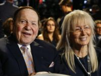 In this Sept. 26, 2016, file photo, Chief Executive of Las Vegas Sands Corporation Sheldon Adelson sits with his wife Miriam waits for the presidential debate between Democratic presidential nominee Hillary Clinton and then-Republican presidential nominee Donald Trump at Hofstra University in Hempstead, N.Y. Adelson has proposed paying for at …