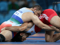 Turkey's Taha Akgul, right, competes against Iran's Komeil Nemat Ghasemi, left, during the men's 125-kg freestyle wrestling gold medal match at the 2016 Summer Olympics in Rio de Janeiro, Brazil, Saturday, Aug. 20, 2016. (AP Photo/Petr David Josek)