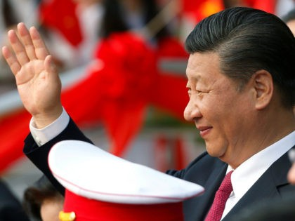 China's President Xi Jinping waves after attending the inauguration ceremony of the Chinese sponsored Vietnam-China Cultural Friendship Palace in Hanoi on November 12, 2017. / AFP PHOTO / POOL / KHAM (Photo credit should read KHAM/AFP/Getty Images)