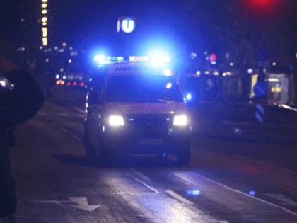 336b0o_austria-knife-attack-62830-an-ambulance-drives-on-street-people-injured