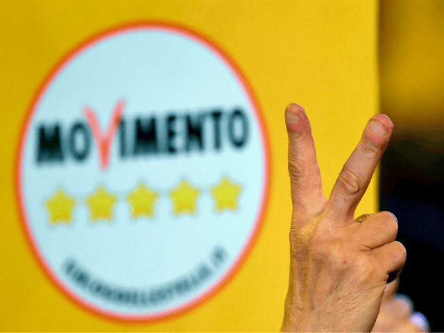 A supporter of the Italy's populist Five Star Movement (M5S) flashes the v for victory sign after the last election campaign meeting in Piazza del Popolo in Rome on March 2, 2018. Italy's anti-establishment Five Star Movement broke with tradition on March 1, 2018, by announcing its list of ministerial …