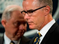 US Attorney General Jeff Sessions (L) looks on as Acting Director of the Federal Bureau of Investigation (FBI) Andrew McCabe (R) speaks during a press conference at the US Department of Justice in Washington, DC, on July 13, 2017. / AFP PHOTO / JIM WATSON (Photo credit should read JIM …