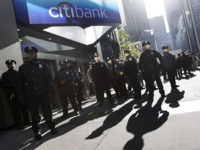 New York City police officers stand guard outside a Citibank branch as protestors associated with the Occupy Wall Street movement march in midtown Manhattan to deliver letters to bank CEOs at their corporate headquarters, Friday, Oct. 28, 2011, in New York. (AP Photo/Mary Altaffer)