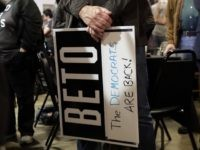 A supporter of senate hopeful Beto O'Rourke holds a sign during a Democratic watch party following the Texas primary election, Tuesday, March 6, 2018, in Austin, Texas. (AP Photo/Eric Gay)