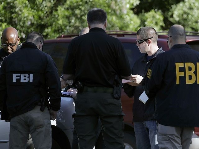 FBI agents work at a scene near the site of Sunday's deadly explosion, Monday, March 19, 2018, in Austin, Texas. Fear escalated across Austin on Monday after the fourth bombing this month — this time, a blast that was triggered by a tripwire and demonstrated what police said was a …