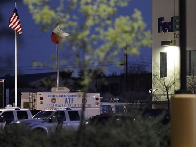 An ATF vehicle sits in front of a FedEx distribution center where a package exploded, Tuesday, March 20, 2018, in Schertz, Texas. Authorities believe the package bomb is linked to the recent string of Austin bombings. (AP Photo/Eric Gay)